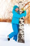 Happy girl hugging tree Royalty Free Stock Image