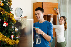 Happy girl with husband cleaning home Stock Image