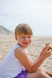 Happy girl with ice cream on beach Stock Images