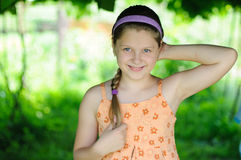 Happy girl. An image of a little happy girl outdoors stock image