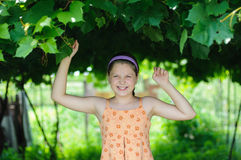 Happy girl. An image of a little happy girl outdoors stock photography