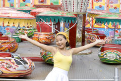 Happy Girl In Amusement Park Royalty Free Stock Photography
