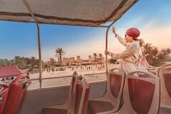 Free Happy Girl In An Indian Headdress Travels On The Roof Of A Bus In A Natural And Historical Park. Desert Safari And Adventure Royalty Free Stock Images - 172286609