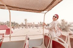 Free Happy Girl In An Indian Headdress Travels On The Roof Of A Bus In A Natural And Historical Park. Desert Safari And Adventure Royalty Free Stock Image - 172390346