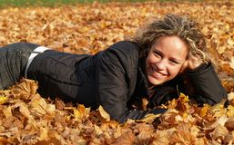Happy Girl In Maple Leaves Stock Images