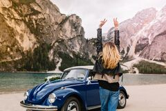 Free Happy Girl In Stylish Attire Having Fun In Italy Looking At Mountains And Funny Dancing With Hands Up. Outdoor Portrait Stock Images - 215216694