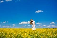 Happy Girl In Yellow Flowers Stock Image
