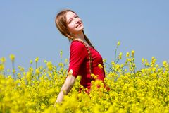 Happy Girl In Yellow Flowers