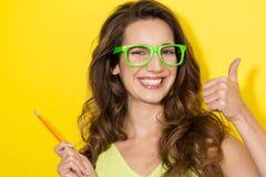Happy girl indicates for presentation Royalty Free Stock Photos