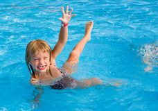 Happy girl int the swimming pool. Stock Photo