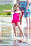 Happy girl invites you to splash Royalty Free Stock Photos