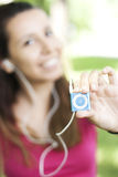 Happy girl with iPod. Young happy woman listening music with an Apple iPod Shuffle Stock Photo