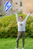 Happy Girl with Israel flag. Image to illustrate election win, patriotic holiday Independence day Israel - Yom Ha`atzmaut and Israeli Memorial Day royalty free stock photo