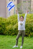 Happy Girl with Israel flag. Image to illustrate election win, patriotic holiday Independence day Israel - Yom Ha`atzmaut and Israeli Memorial Day stock image