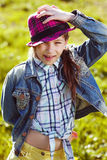 Happy girl in a jacket and hat Royalty Free Stock Image