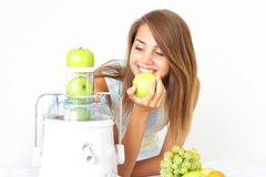 Happy girl about juicer Stock Image