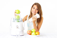 Happy girl about juicer Royalty Free Stock Images