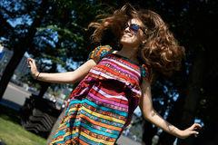 Happy girl jumping. In summer park Stock Photography