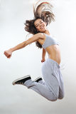 Happy girl jumping. Aerobic instructor exercising in studio Stock Photo