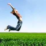 Happy girl jumping Stock Photo