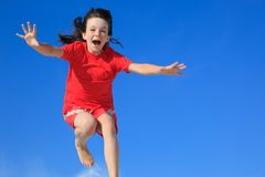 Happy girl jumping in air stock photos