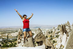 Happy girl jumping on the background of the cave city in Cappado Royalty Free Stock Images