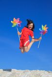 Happy girl jumping on beach Royalty Free Stock Photo