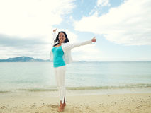 Happy girl jumping on the beach Royalty Free Stock Images