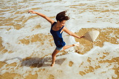 Happy girl jumping on the beach top view Royalty Free Stock Photography