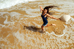 Happy girl jumping on the beach top view Stock Photography