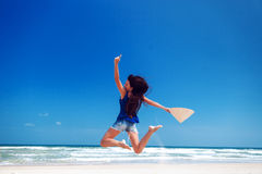 Happy girl jumping on the beach Stock Images
