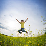Happy girl jumping Stock Photography