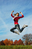 Happy girl jumping of joy Stock Photography