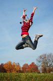 Happy girl jumping of joy Royalty Free Stock Photography