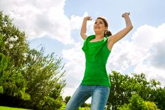 Happy girl jumping outdoors. Royalty Free Stock Images