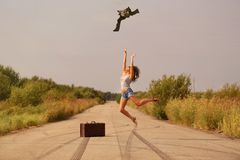 Happy girl jumping on the road Royalty Free Stock Images