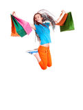 Happy girl jumping with shopping bags Stock Photos