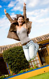 Happy girl jumping and smiling Stock Photos