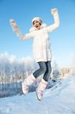 Happy girl jumping in the snow Royalty Free Stock Photography