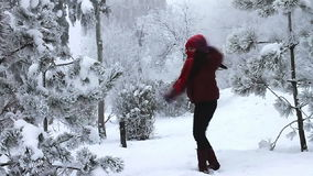 Happy girl jumping in the snow stock video footage
