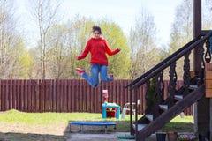 Happy girl jumping Stock Photo