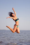 Happy Girl jumping. Girl jumping from the water stock photos