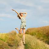 Happy girl jumping Royalty Free Stock Photography
