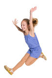 Happy girl jumps. A happy girl jumps on the white background Royalty Free Stock Photos