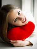 Happy girl keeps the heart Royalty Free Stock Images