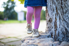 Happy girl-kid walking with her mother in city park Stock Photography