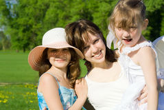 Happy girl with kids Stock Photography