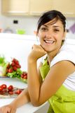 Happy girl in the kitchen ready to eat salad Royalty Free Stock Photography