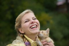 Happy girl with kitten Stock Image