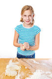 Happy girl kneads dough for pie on kitchen table isolated Stock Image